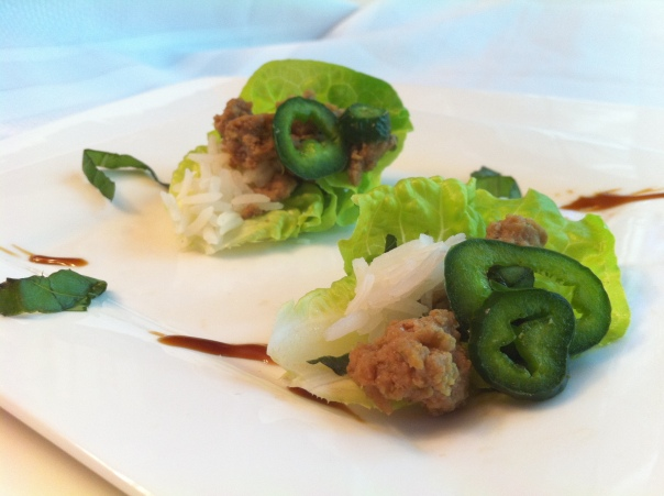 Mini Thai Basil Turkey Lettuce Cups with Garnishes of Jasmine Rice, Poblano Pepper, Oyster Sauce & Chiffanade of Basil.